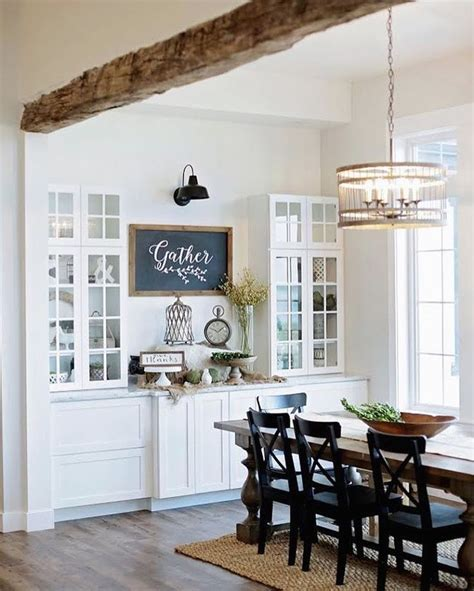 white cabinets, glass front uppers, black accents, and x