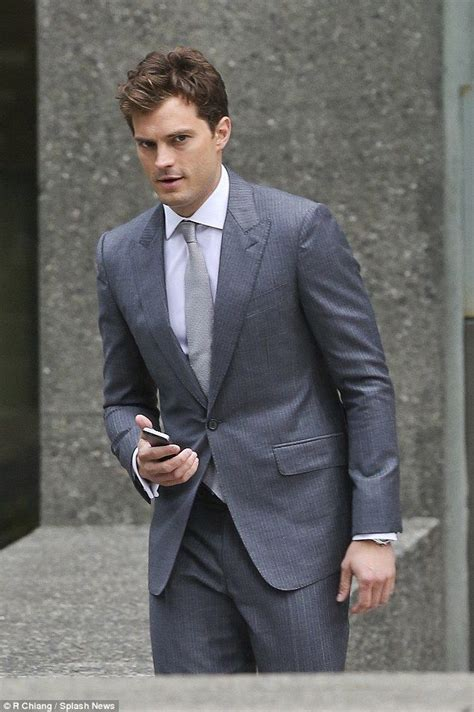 shaving in shades of gray jamie dornan is clean shaven in a smart suit for fifty
