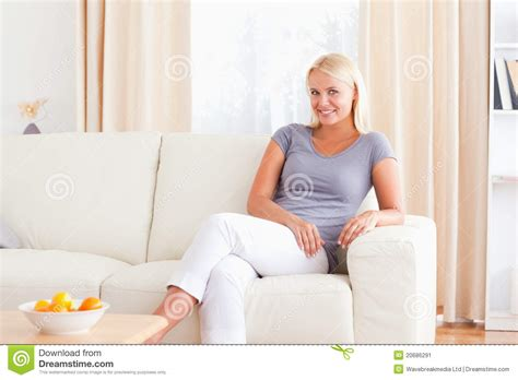 on couch video woman sitting on a couch stock image image of enjoy