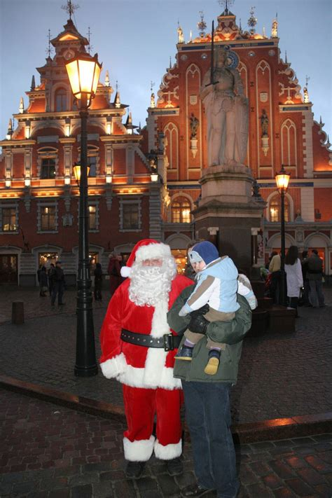 santa claus visits home    christmas tree riga
