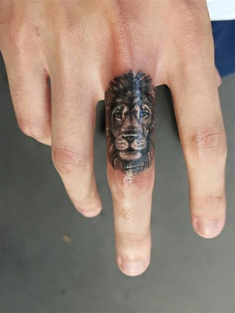 x tattoo on middle finger 25 beautiful small lion tattoo ideas on pinterest small