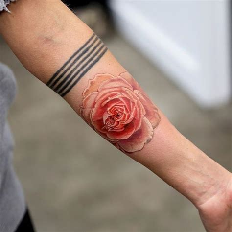 realistic rose tattoo by mikhail andersson