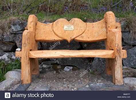 carved wooden benches chainsaw carved wooden bench memorial loch laich portnacroish argyll stock photo