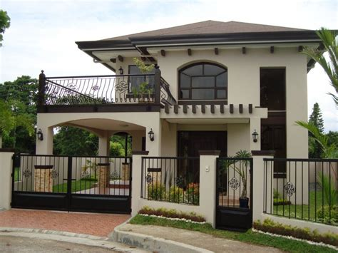 two storey house facade design stylish facade of two storey house with iron fences part of architecture two storey