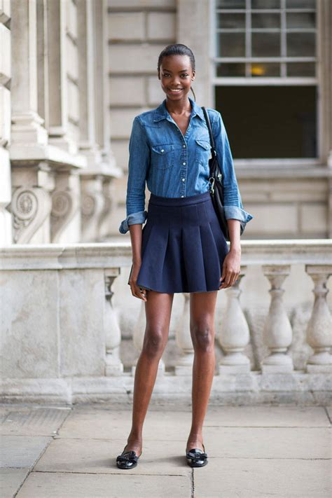 s blue denim button shirt black leather tote