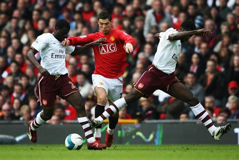 arsenal ronaldo 7 cristiano ronaldo and emmanuel eboue photos photos