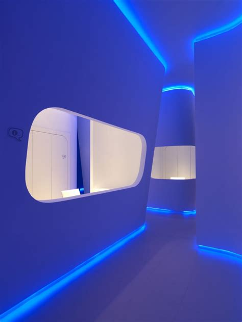 interior gleaming futuristic room with blue led lights also hidrosalud headquarters offices design by cuartopensante