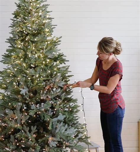 best way to light christmas tree tutorial for adding lights to a tree sincerely d