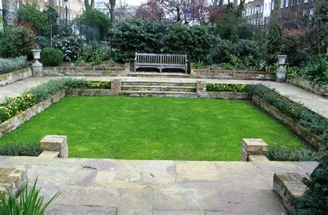 sunken garden with reclaimed yorkstone and lawn simon