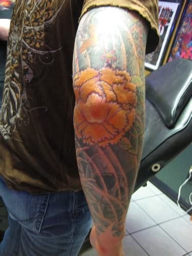 elbow flower tattoo designs yellow flower on