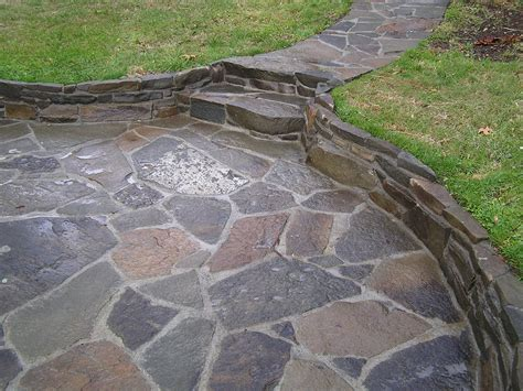 add mortar between our flagstone for the patio and the side yard walk add decorative elements
