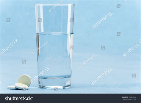 Barkin Throws A Glass Of Water In The Of Ex Husband 2 by Soluble Tablet Throw In Water Glass On Blue Background