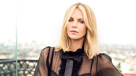 Charlize Theron Pictures charlize theron wallpapers images photos pictures backgrounds