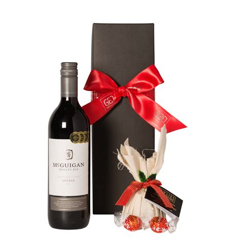red wine with christmas chocolates gift baskets direct