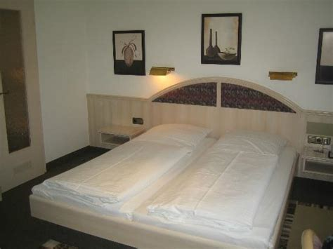 bed in german room with double bed and bathroom door picture of hotel