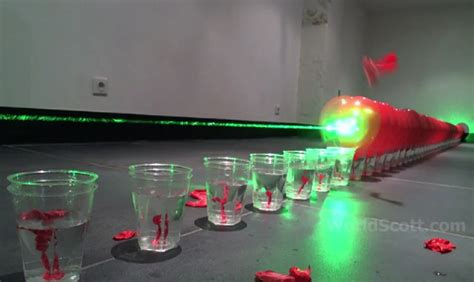 Laser Popping Balloons by Balloon Dominos Popping 100 Balloons With A Laser