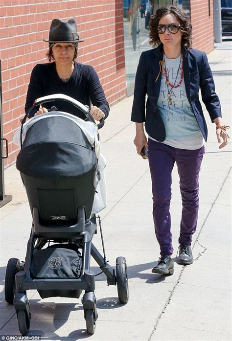 Sara Gilbert and Linda Perry take their new baby Rhodes