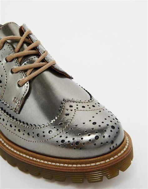 bronze flat shoes lyst bronx bronze brogue flat shoes in metallic