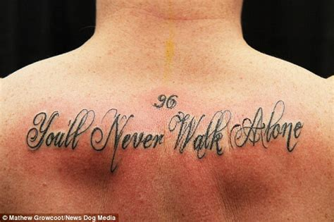 tattoo fixers you ll never walk again everton fans gets liverpool slogan tattooed on his back to