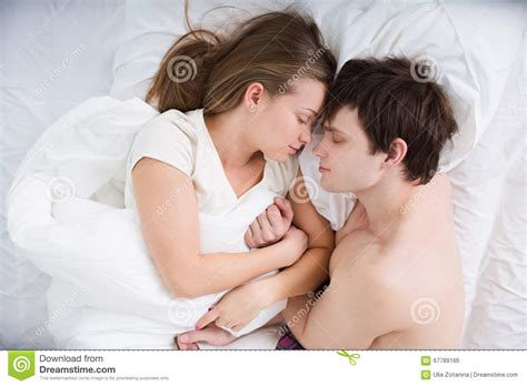 romantic couple in bed images happy young couple lying in bedyoung couple sleeping in