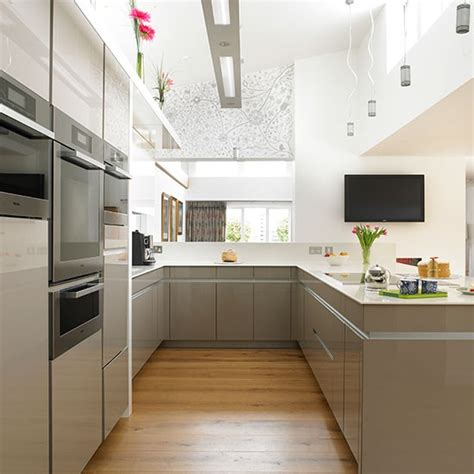 off white cabinetry paired with a glossy neutral tile neutral hi gloss kitchen with oak floor kitchen
