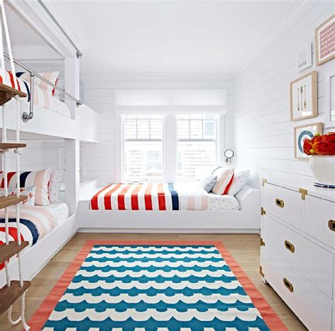 boys blue and red bedroom beach bungalow kids room with white rope bunk bed ladder