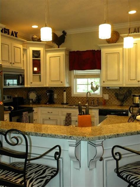 red kitchen cabinets with black glaze black glazed ivory cabinets traditional french country red