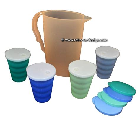 tupperware pitcher and cups with lids and straw slots