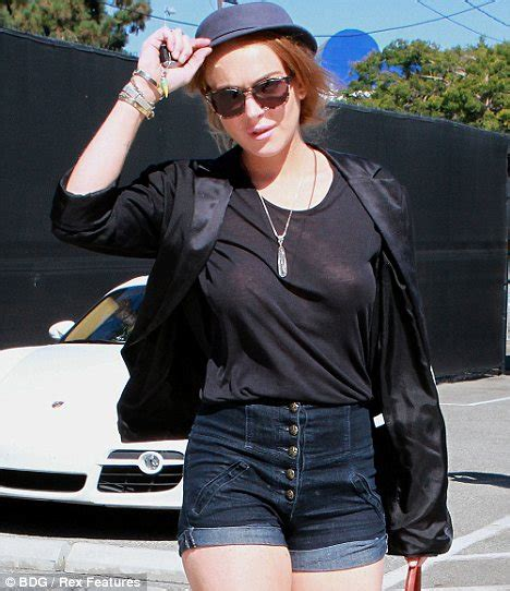 lindsay lohan strips down to see through top revealing