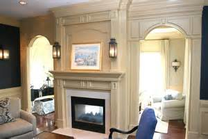 fireplace mantle with doorway trim and crown molding yelp