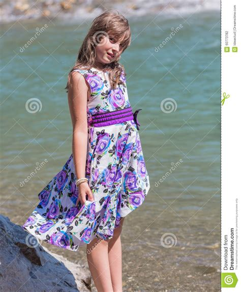 cute preteen cute preteen long hair girl on riverbank stock photo