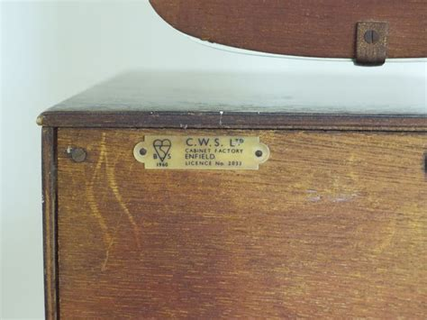 C W S Cabinet Factory Enfield Made In England Logos