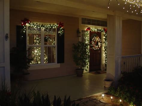 lighted garland around door and wreath merry christmas y