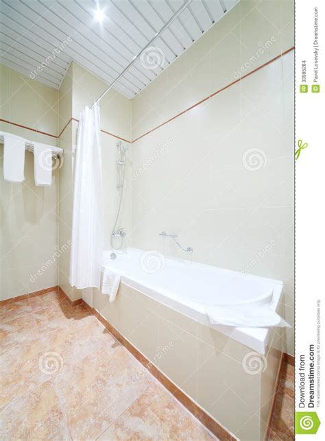 What To Clean Tub With When Empty white simple clean bath in light and empty bathroom stock