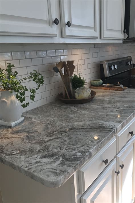 gray countertops with brown cabinets fantasy brown granite with small white subway tiles and