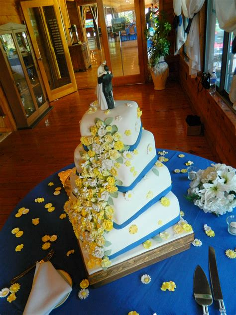 Wedding Cakes With Yellow And Purple Flowers by 4 Tier Yellow And White Flowers Offset Square Wedding