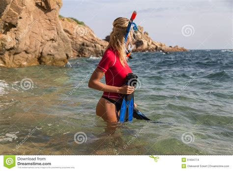 sexi dive diver in sportwear preparing dive stock photo