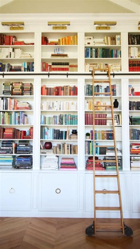 library with painted built in shelves brass picture