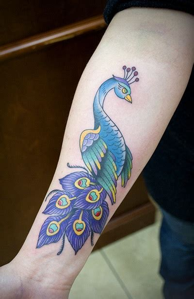 side of forearm tattoos peacock inklings peacock