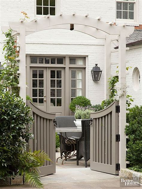 Garden Arbor With Gate White Inspired By Charming Garden Gates The Inspired Room