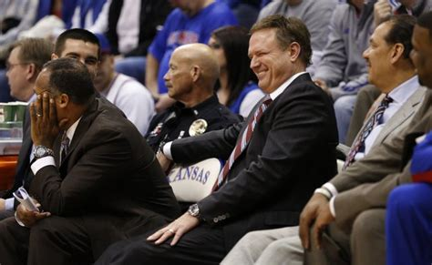 bench assistant photo kansas head coach bill self laughs on the bench