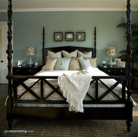 beach themed master bedroom master bedroom with aqua walls dark wood bed cream