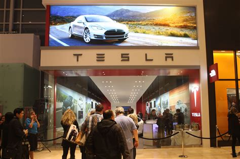 tesla selling eco cred marketing magazine