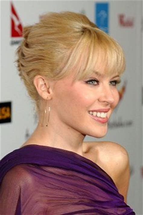 casual chignon updo hairstyle for women kylie minogue hairstyle kylie minogue classic french twist hair style with bangs