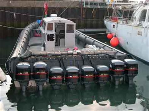 big rib boat eight outboard drug runner boat photograph