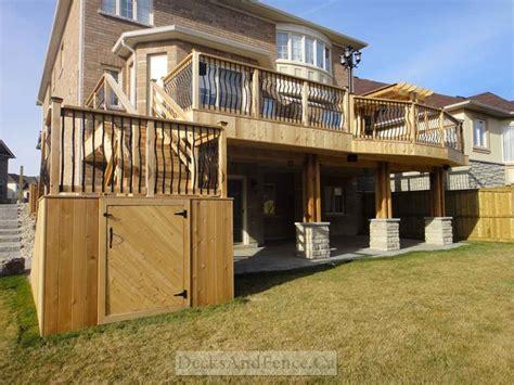 deck with walkout basement designs 2 level cedar deck with walkout basement and pergola