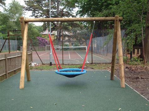 large swings bird s nest large inclusive play swing setter play esi