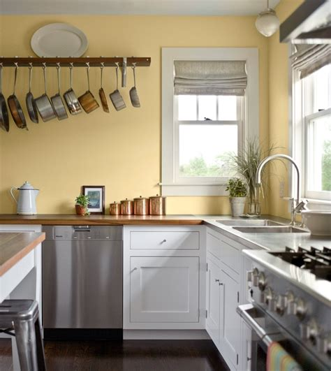 wall of kitchen cabinets pale yellow walls white cabinets wood counter tops