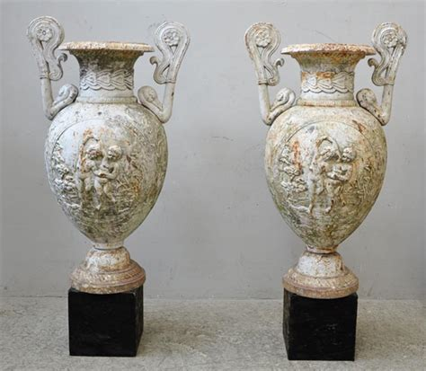 Antique Looking Vases by Antique Pair Of Cast Iron Vases With Putti Planters
