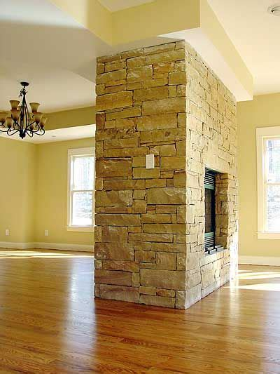 fireplace in middle of room plan 16702rh energy efficient bungalow fireplaces see through fireplace and middle
